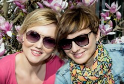 http://www.dreamstime.com/stock-image-two-young-caucasian-women-posing-blooming-magnolia-s-beauty-fashion-image39458781